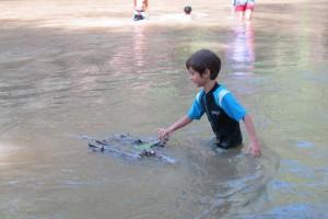 Panyaden Summer School students dredging for small sea creatures