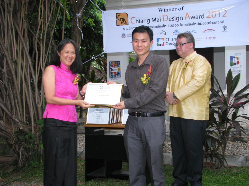 Panyaden School founder receiving award for excellence in architecture & design from Mayor of Chiang Mai