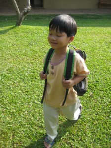 Kindergarten student arriving at Panyaden, green bilingual school in Chiang Mai