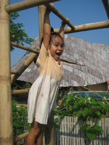 Happy student at Panyaden School playground. Panyaden is a bilingual school in Chiang Mai.