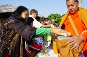 Panyaden School founder offering food to monks in Chiang Mai