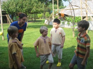 Native English speaking teacher with mixed group of students at Panyaden, bilingual school in Chiang Mai