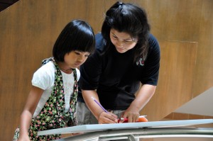 Panyaden School teacher with Thai student at museum