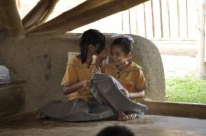 Panyaden School students acting their roles as 'gossippers' in school performance