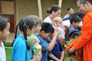 Panyaden School students offering food to Chiang Mai monks at school