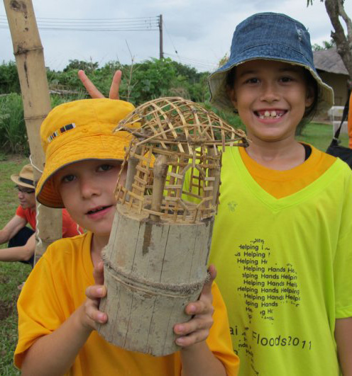 Panyaden students showing off their bamboo house model for their self-directed learning project
