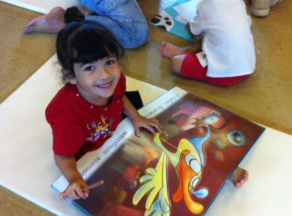 Panyaden kindergarten student reading in the school library