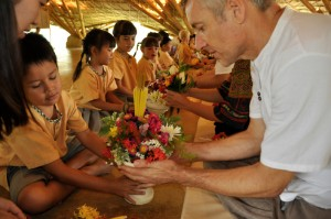 Director and teachers of Panyaden School in Chiang Mai receiving fower tributes on Wai Kru Day