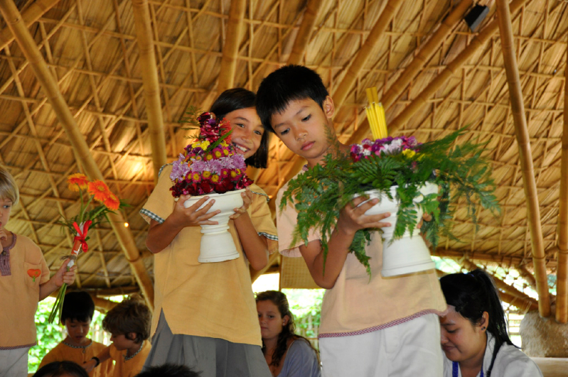Panyaden School primary students with flowers for their teachers