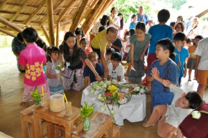 Flower offerings by Thai and foreign students and staff of international school in Chiang Mai