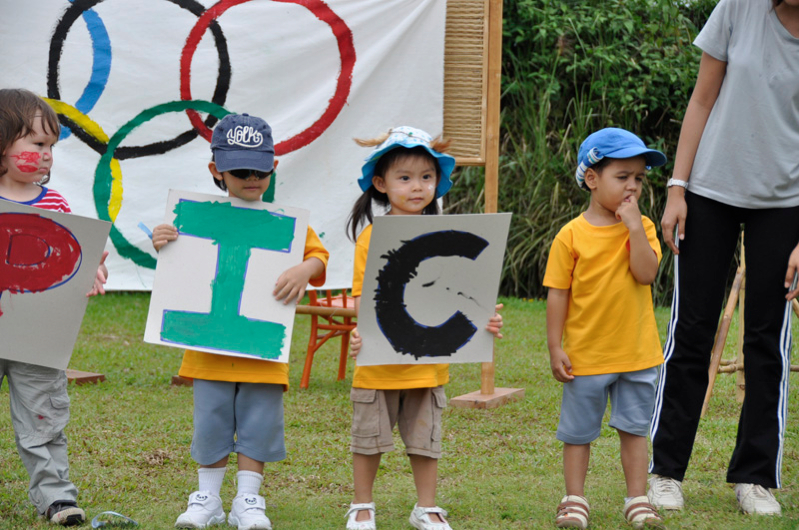 Kindergarten students spelling out 'Olympics' at Panyaden School Chiang Mai