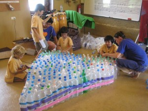 Panyaden students working together to recycle plastic bottles for their school project