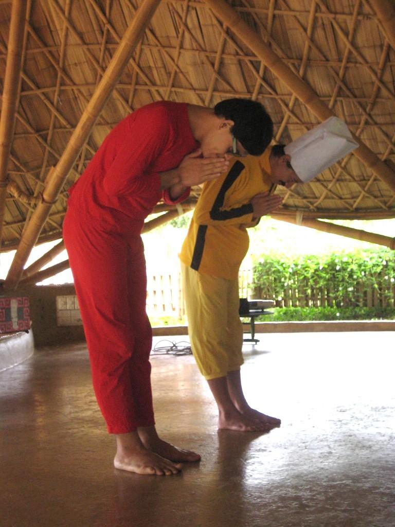 Teachers of Panyaden International School doing the Thai 'wai'