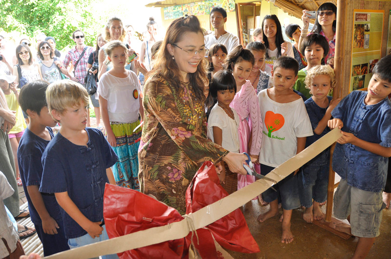 Parent cutting ribbon at My Project Grand Opening, Panyaden School Chiang Mai