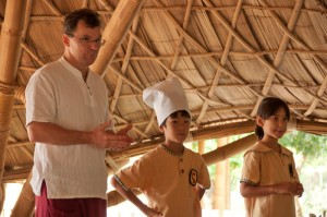 Head teacher with students at bilingual wise habit session, Panyaden School