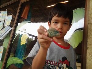 Panyaden Summer School 2013 student showing off his painted rock