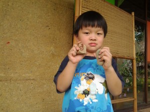 Panyaden student with his painted rock, Summer School Chiang Mai