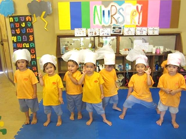 Nursery students with chef hats they made - part of lesson about different occupations, Panyaden School Chiang Mai