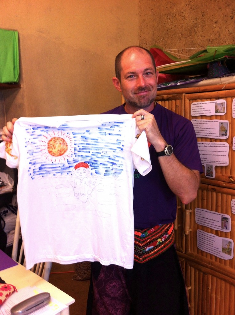 IMG_1180 Prathom homeroom teacher with his finished T-shirt for Panyaden School Philippines Appeal in Chiang Mai