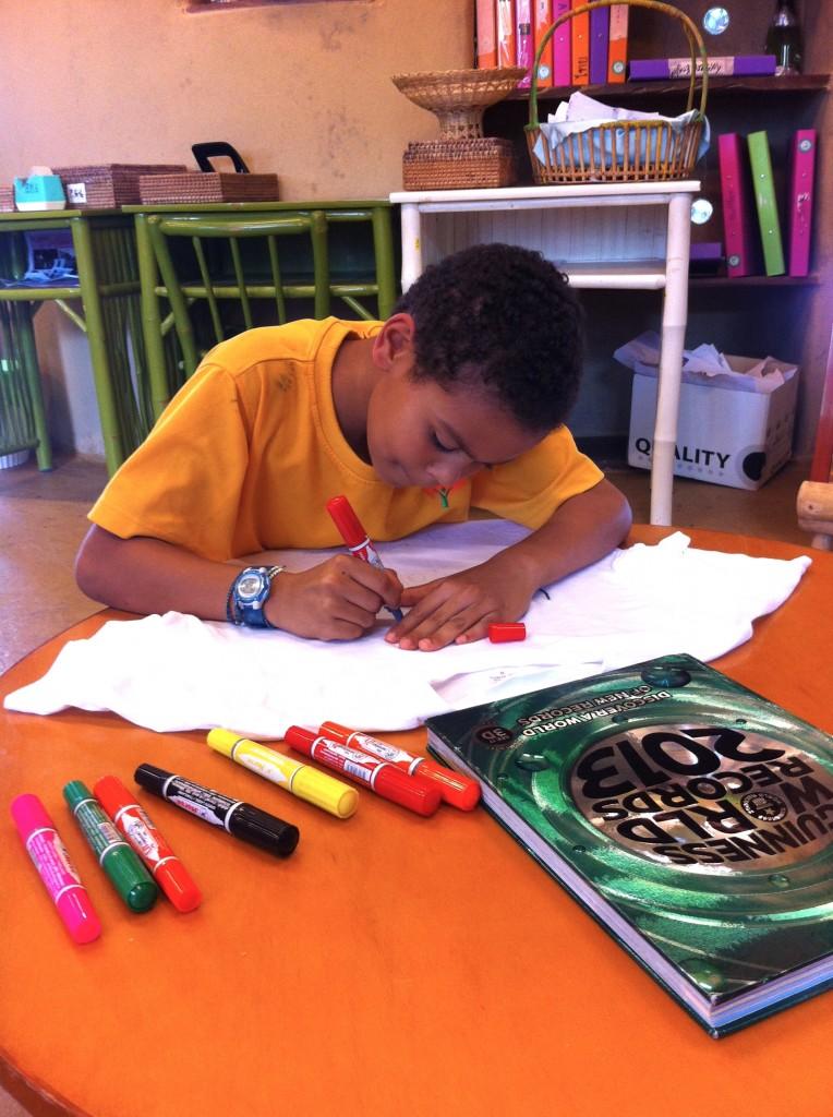 Student designing T-shirt, Panyaden School Philippines Appeal