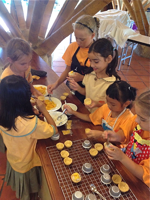 Panyadn students of Young Chef Club makiing their special dessertng