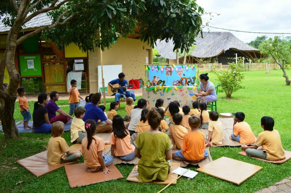 Panyaden students watch a puppet show about the Thai Alphabet