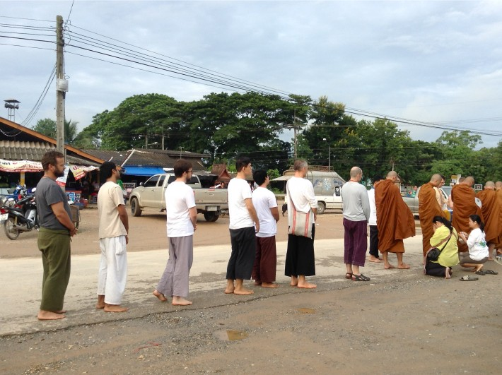 Panyaden staff go on morning alms round with the monks