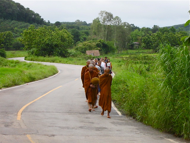 Panyaden staff following the monks on their morning alms round