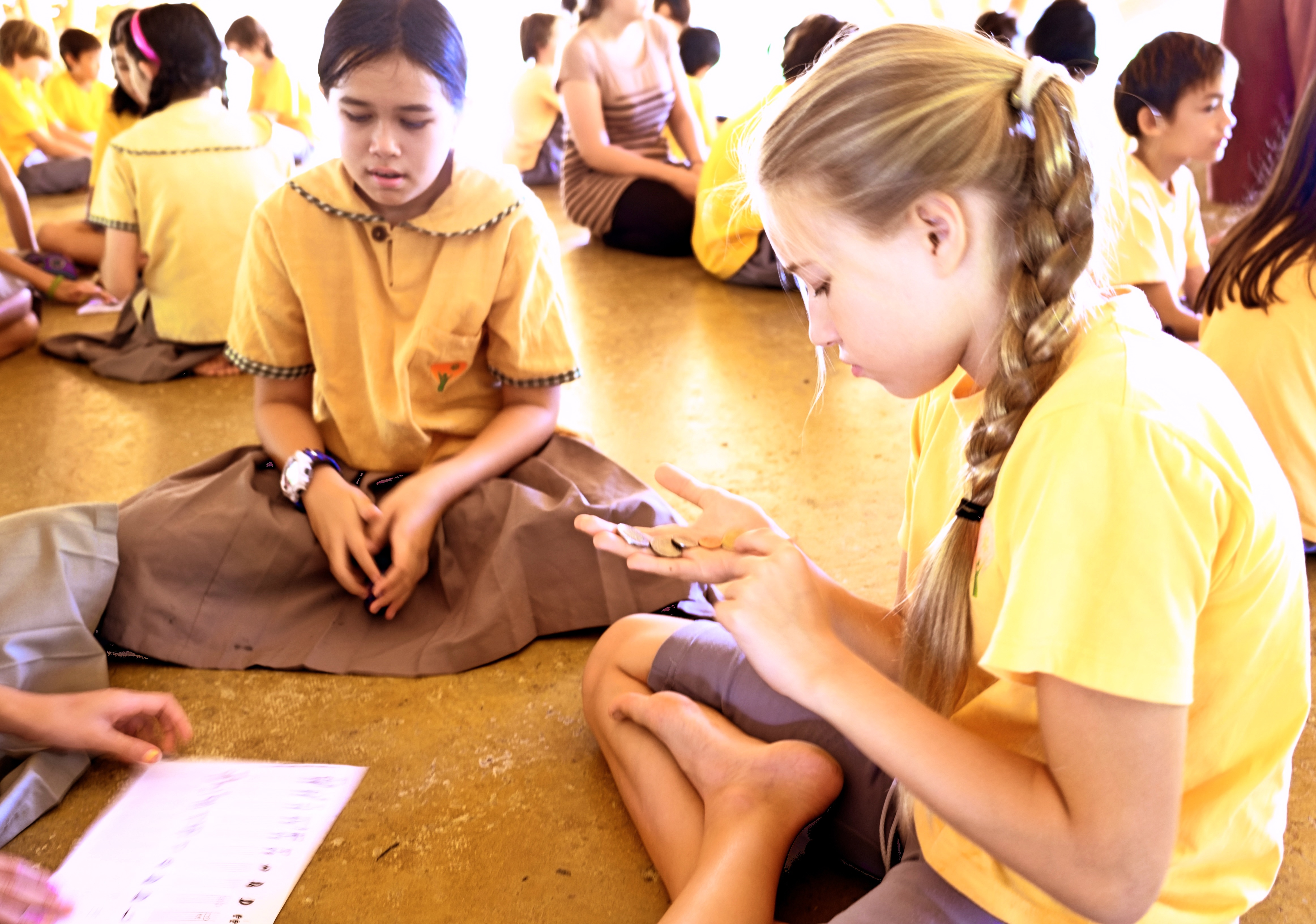 Prathom students engaged in coin game