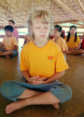 Panyaden School Prathom student practising meditation at school