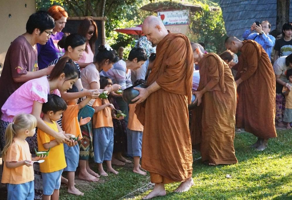Panyaden offering alms this morning