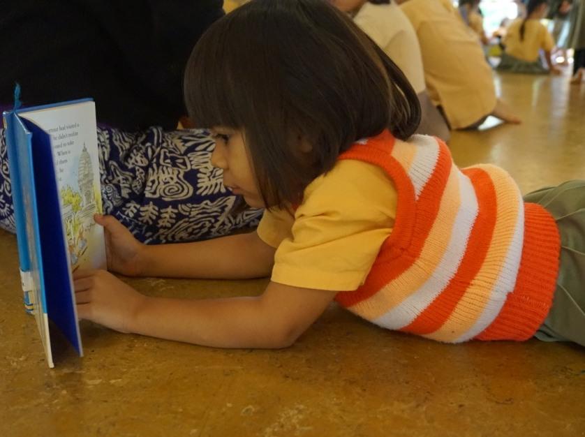 Panyaden student reading at school assembly hall