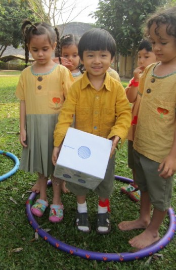 Kindergarten 1 (K1) students play a game with a giant dice, Panyaden School