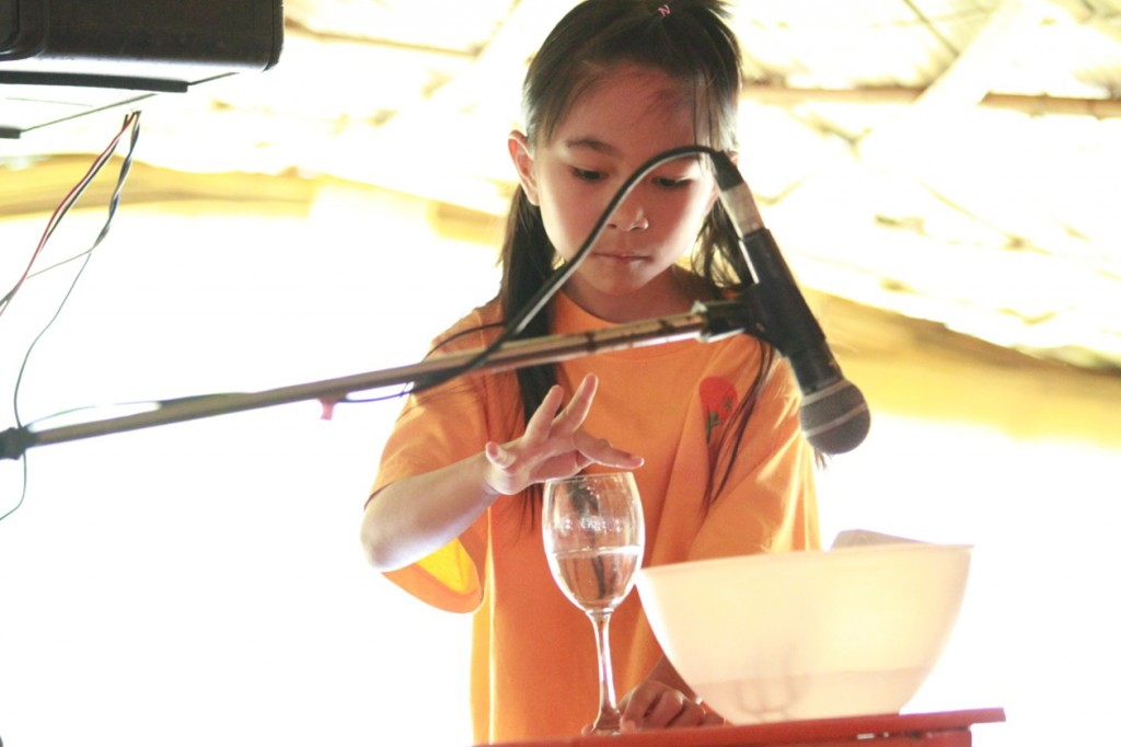 _MG_0905 Panyaden student creating sound effects with a glass of water, Blossom Day 2015