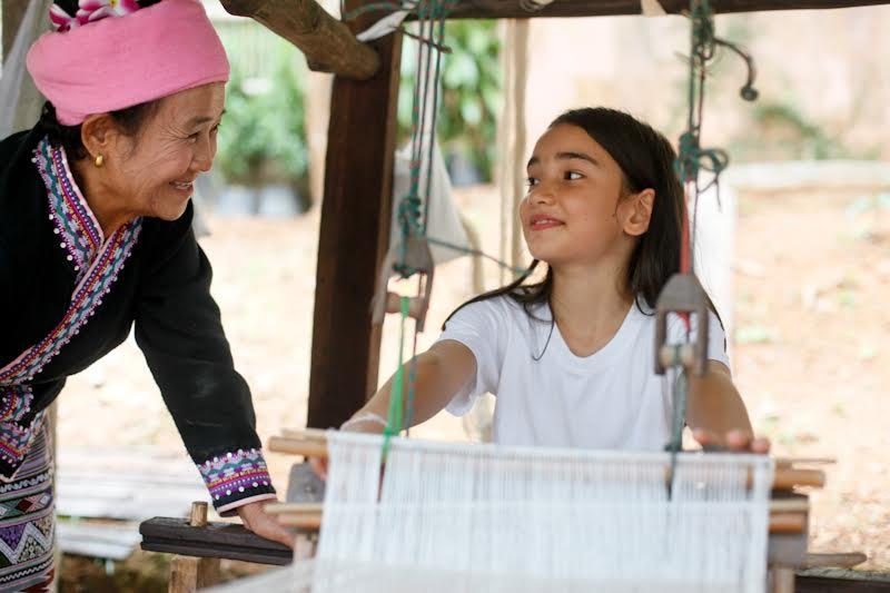Student learns traditional Thai cotton weaving at Panyaden School