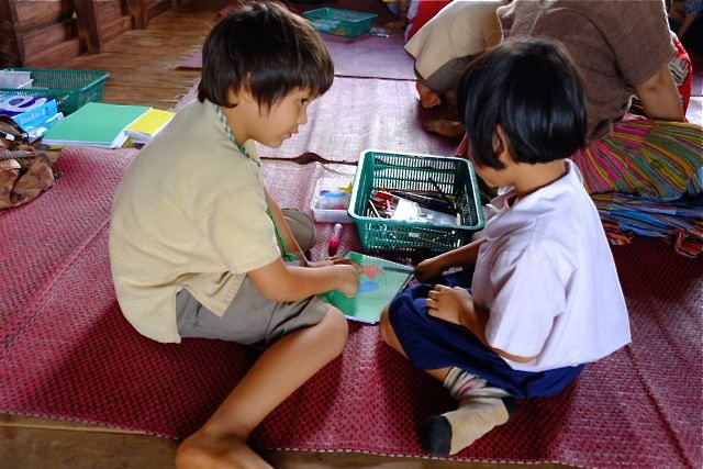 Panyaden student drawing with Rappaport School student in Bor Kaew, Sameong, part of our annual social contribution initiative