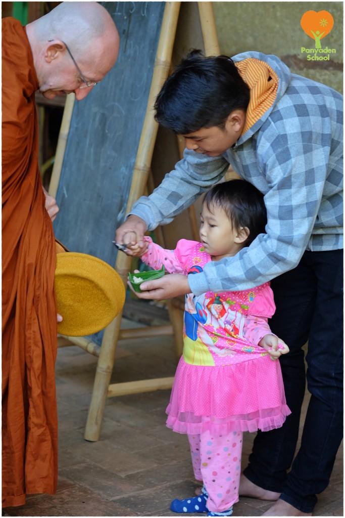 DSCF7798 Offering alms to Ven. Ajahn Amaro, Panyaden School, Thailand