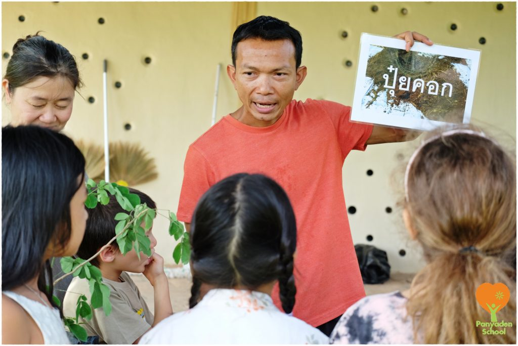 DSCF1957 Life Skills teacher teaching students about sowing tree seedlings, Panyaden School Chiang Mai