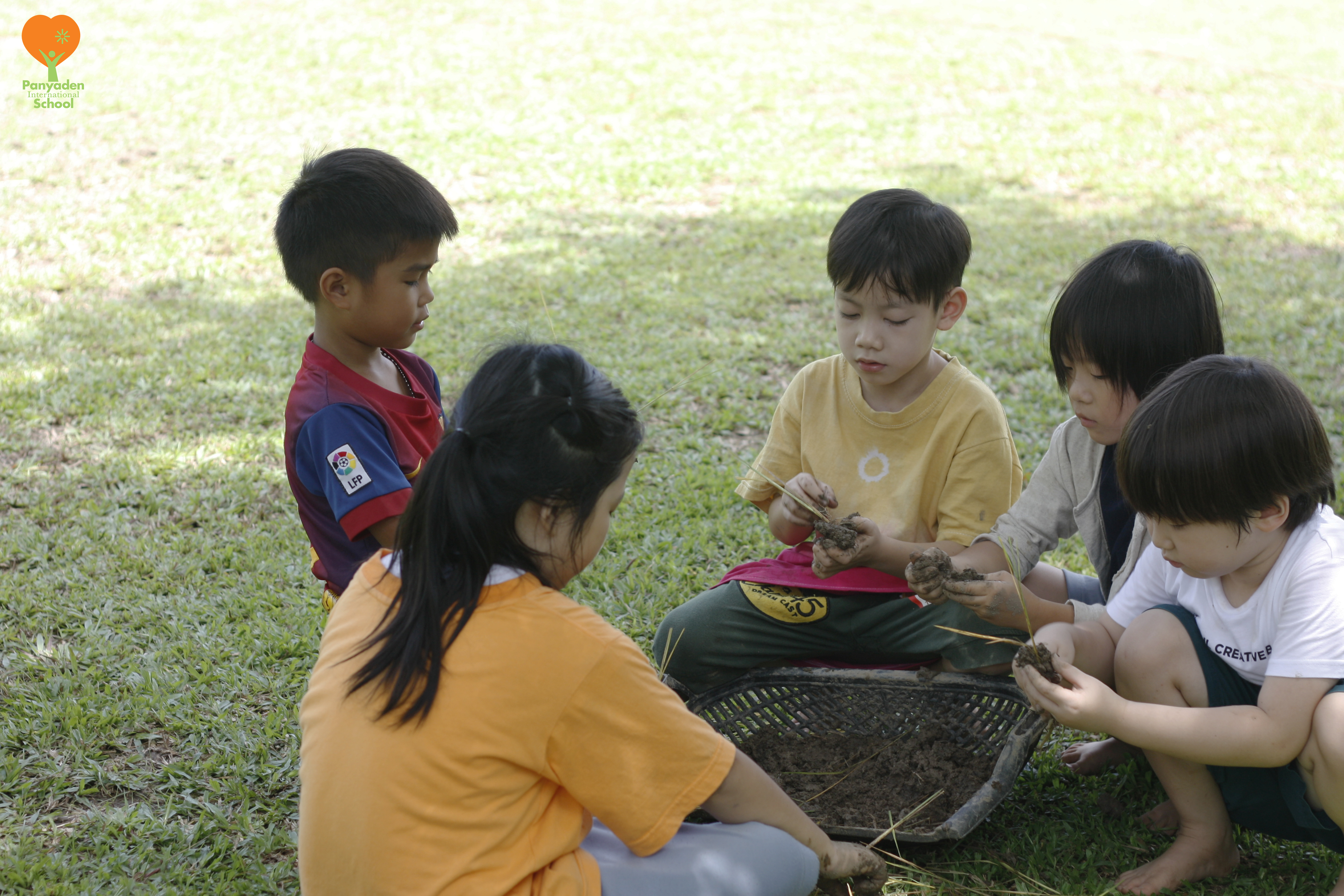_MG_7874-logo Panyaden Year 1 students making rice seed balls for planting at school