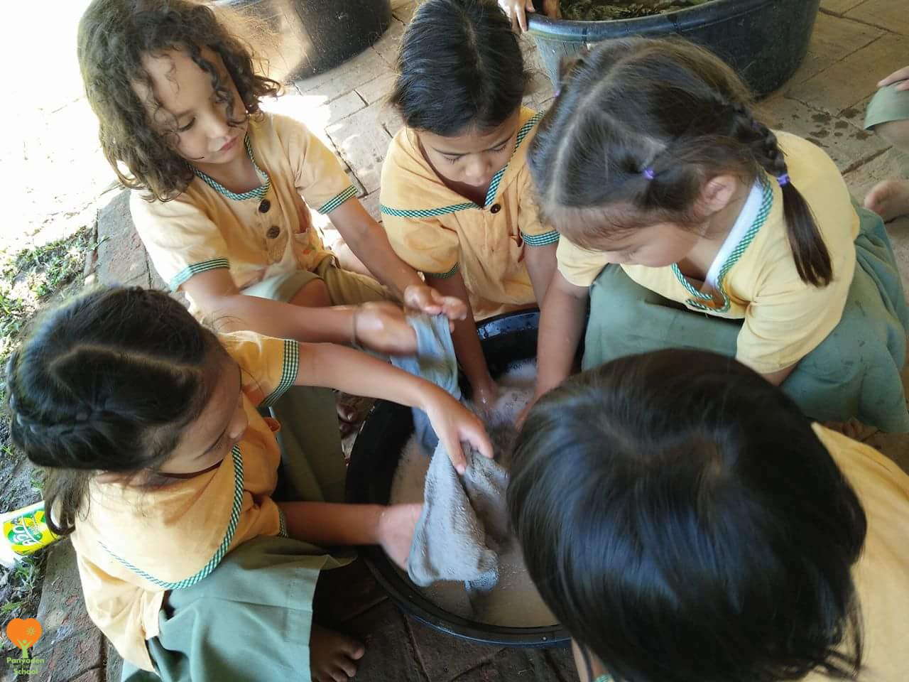 Year 1 students washing towels at school, Panyaden International School Life Skills class