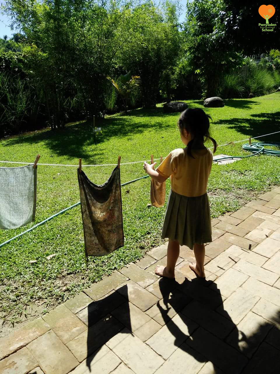 Time to hang out the washing! Panyaden International School student during Life Skills class