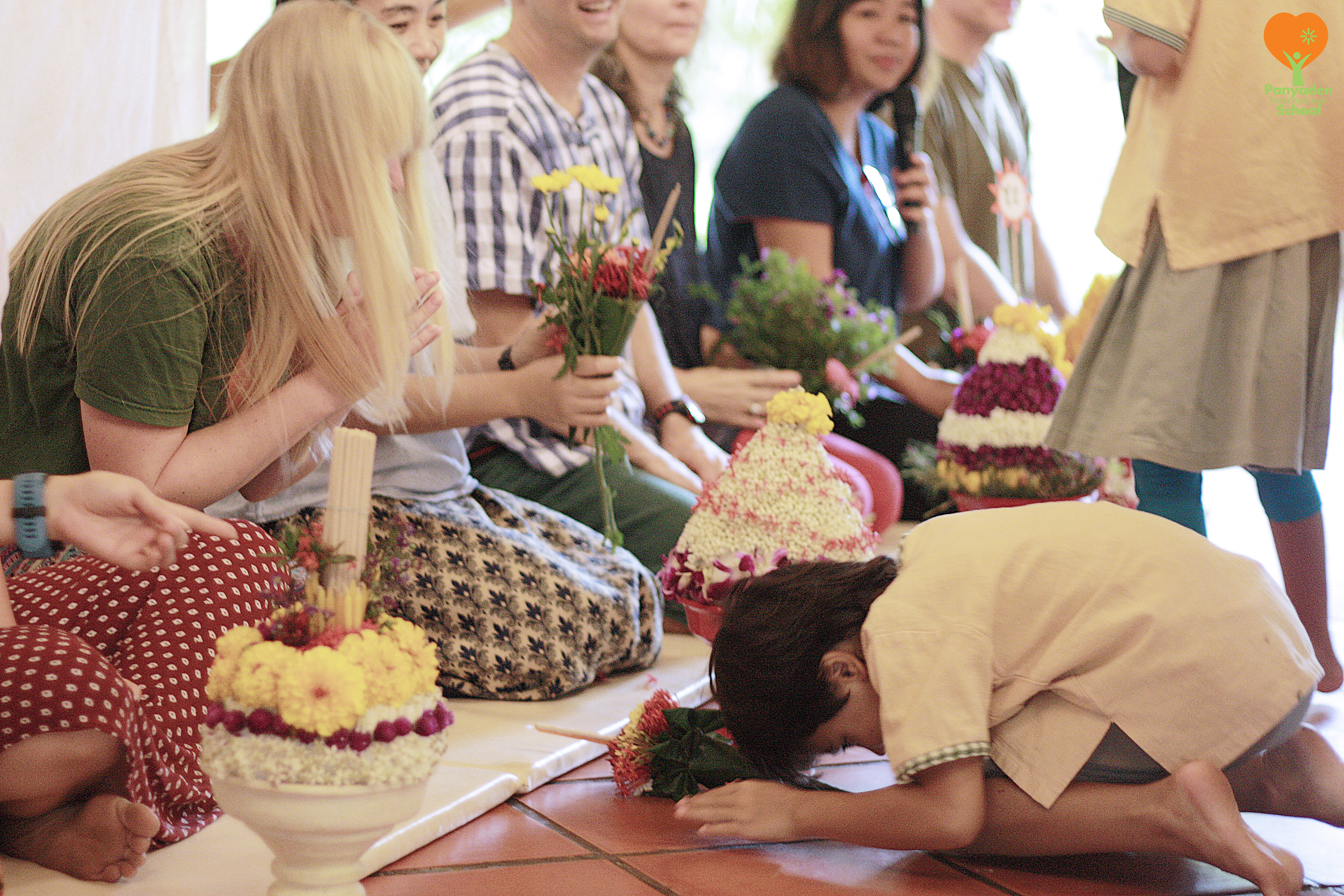 Panyaden student paying respects to teacher on Wai Kru Day
