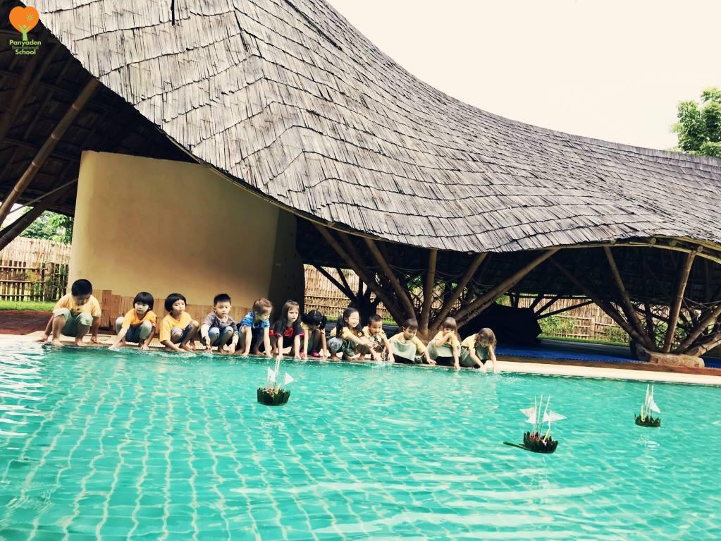 Panyaden International School Kindergarten 2 students testing out their handmade krathongs at the school swimming pool