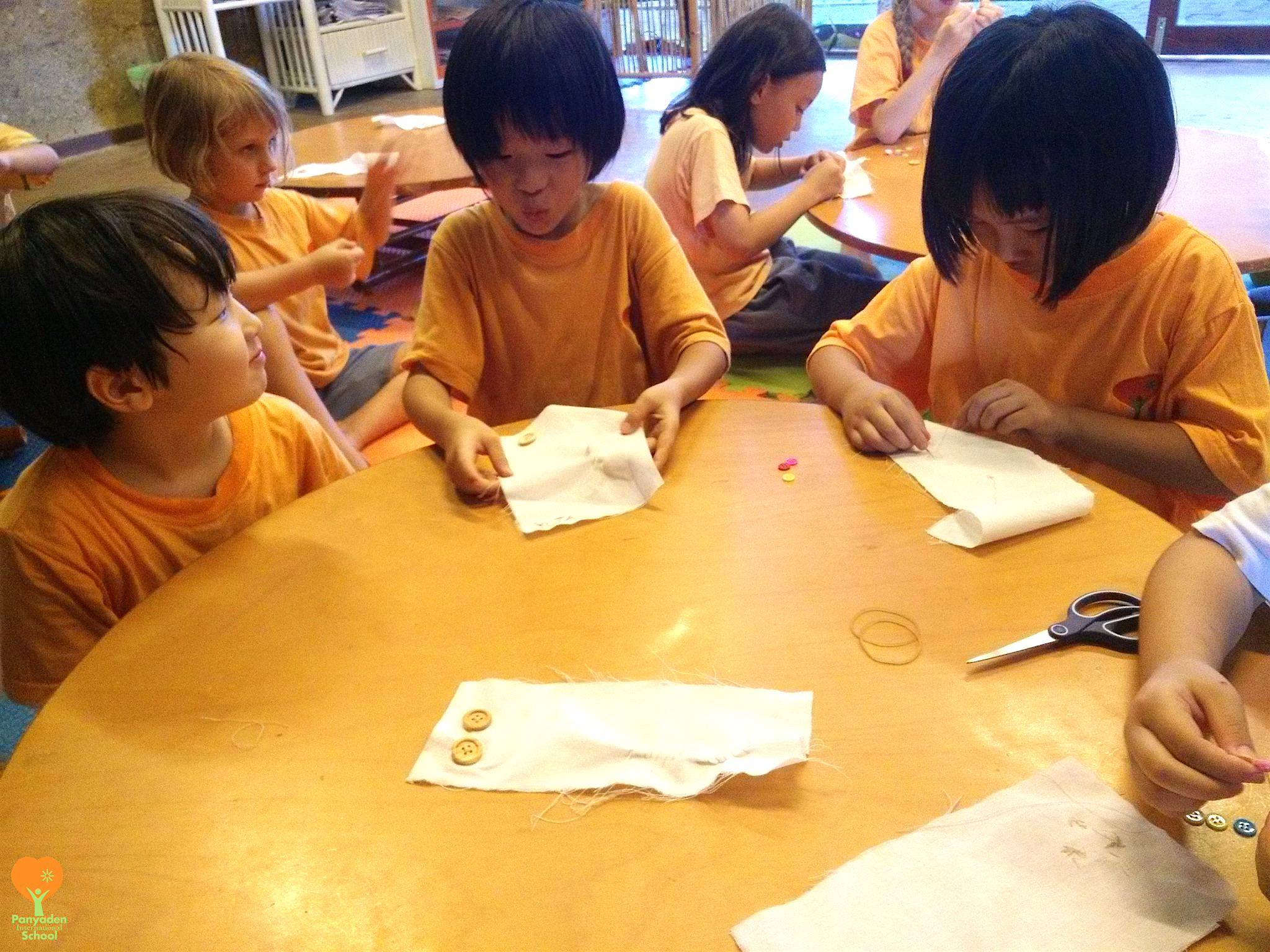 Year 2 students learn to sew on buttons during Panyaden Life Skills class