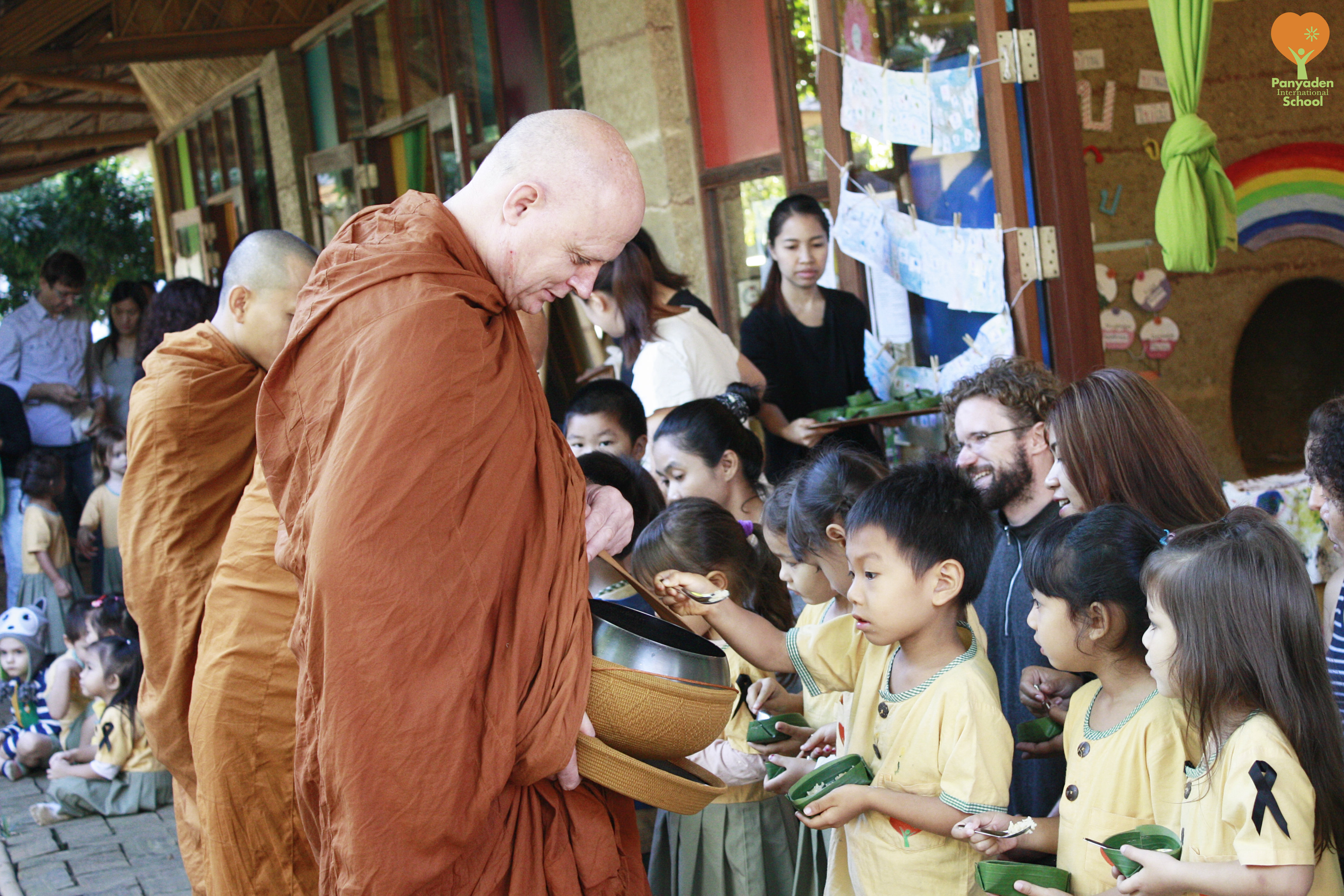 Morning alms offering to Ven. Ajahn Jayasaro at Panyaden