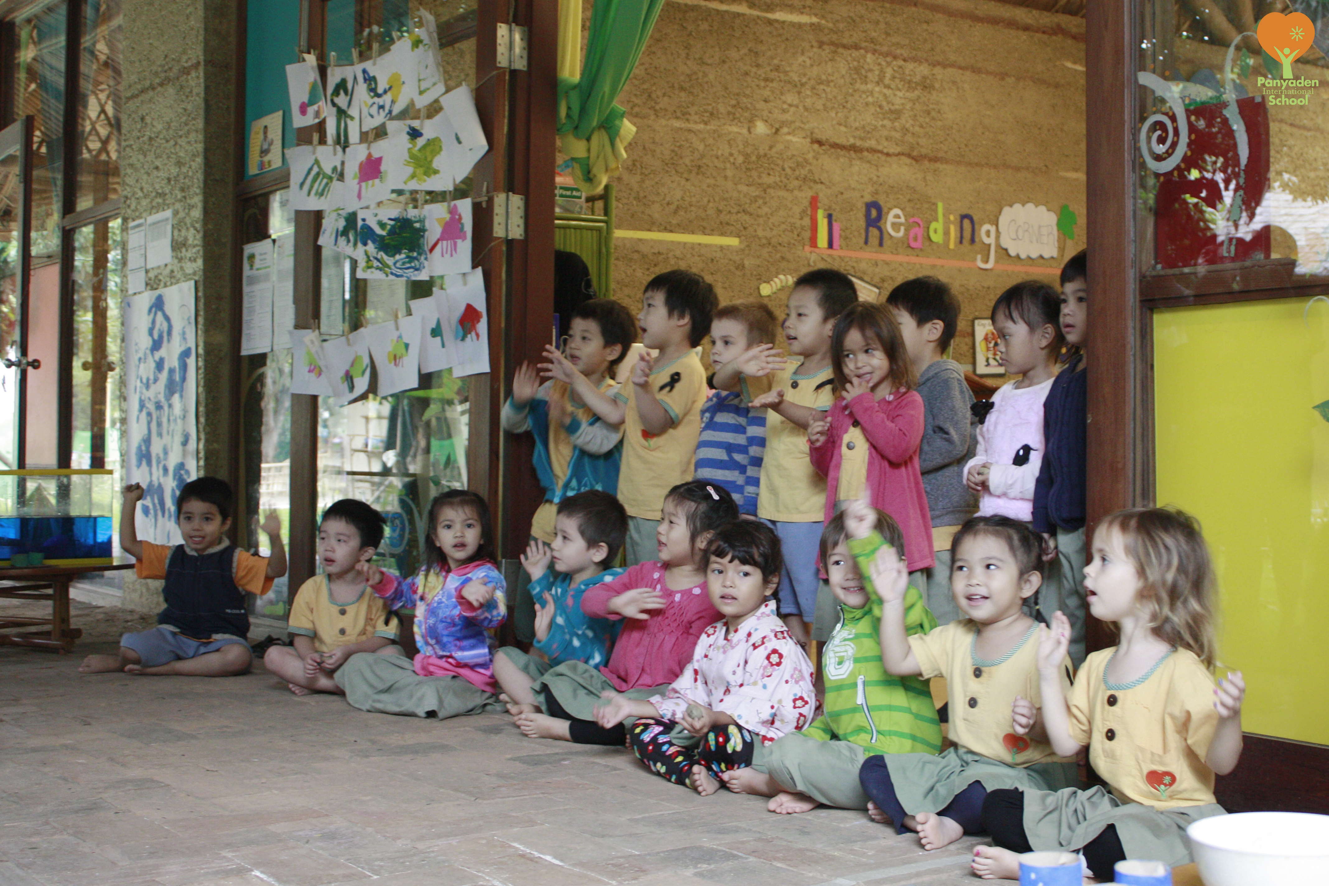 Preschool students perform a song for their parents on Panyaden's Budding Day
