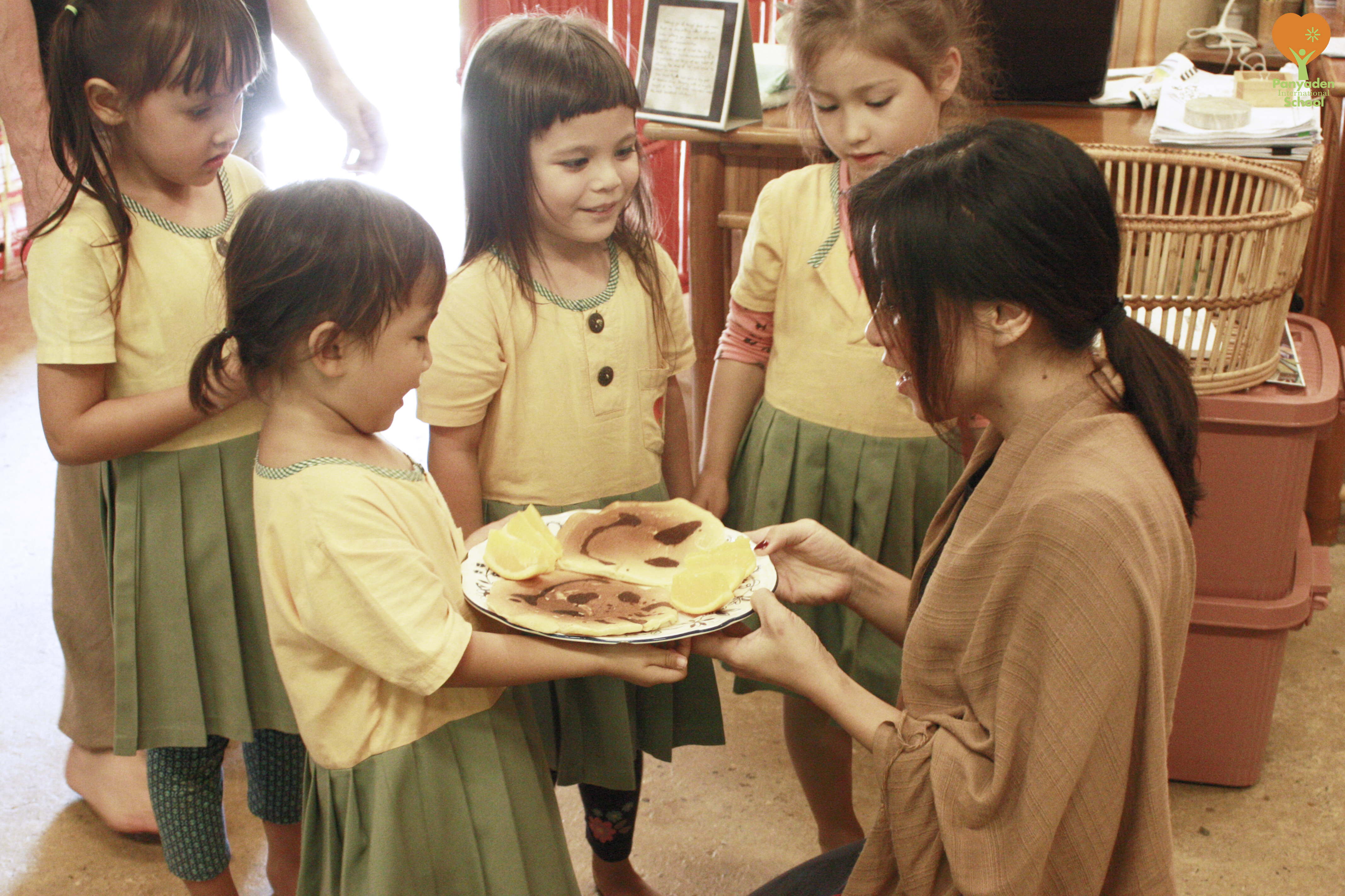Panyaden's kindergarten children present school staff with pancakes they made as a thank you, Giving Week 2016