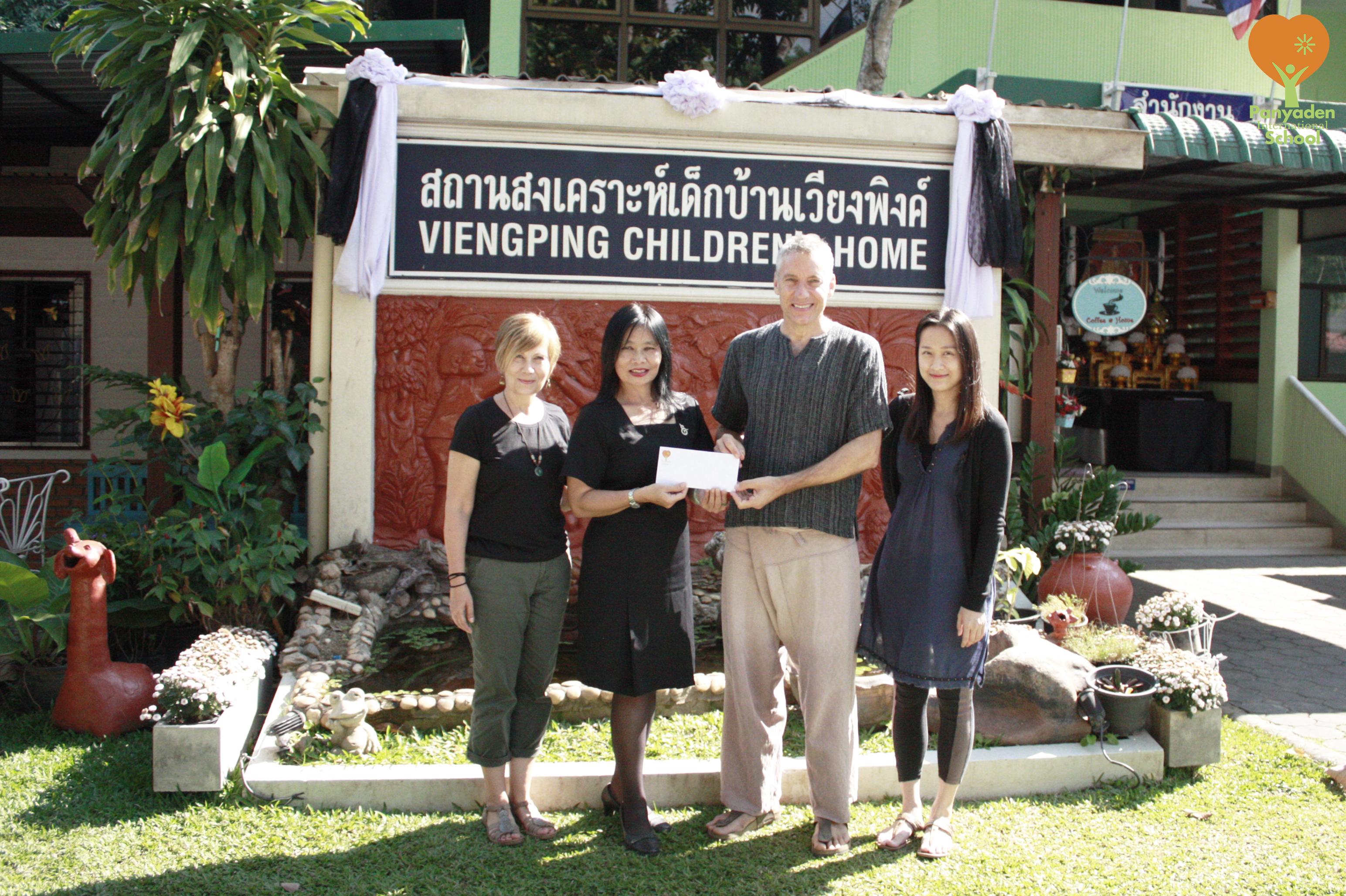 Panyaden International School Director hands over cheque from the school to Viengping Children's Home