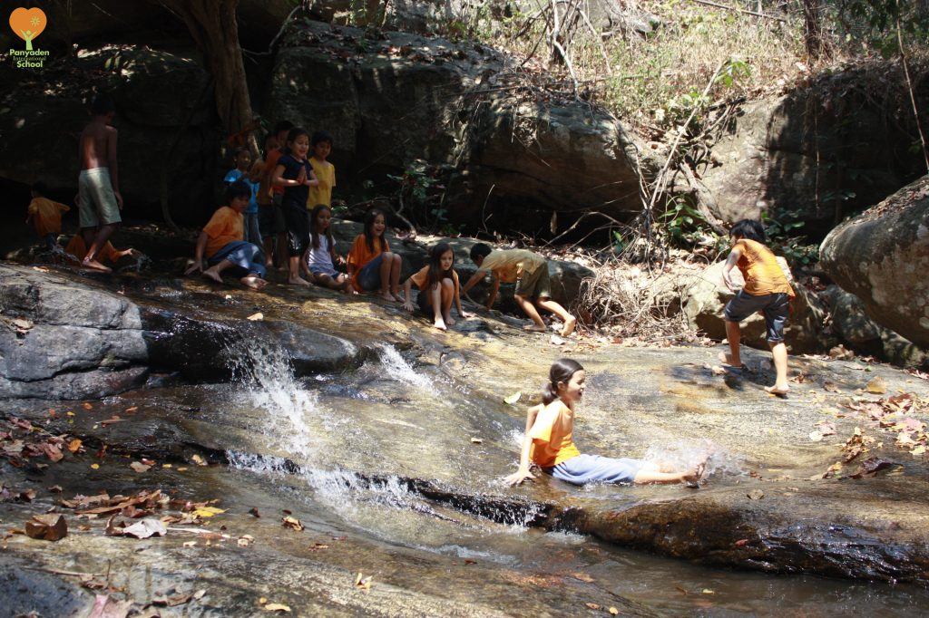 Panyaden Social Contribution Day 2017: students enjoying the water during their break from clearing rubbish at Huay Kaew waterfall
