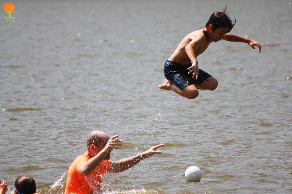 Jumping into the lake, Panyaden students at Huay Tung Tao Chiang Mai